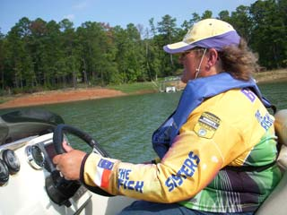 Linda fishing on lake in her bass boat testimonial