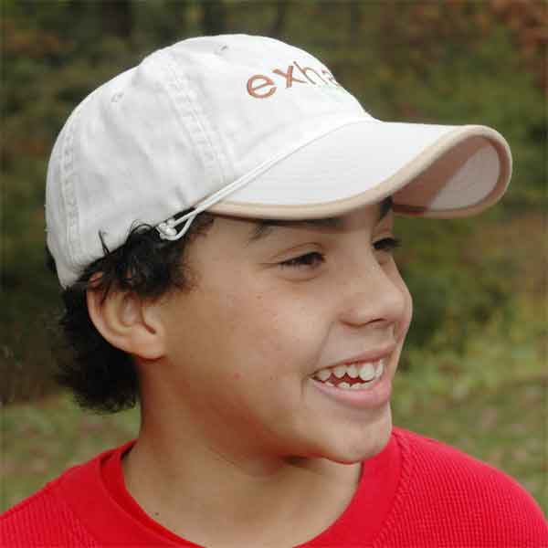 Boy wearing baseball cap with Capsurz® on brim