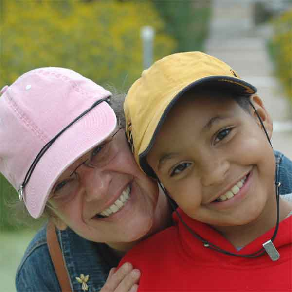 Woman and child wearing Capsurz® on baseball cap