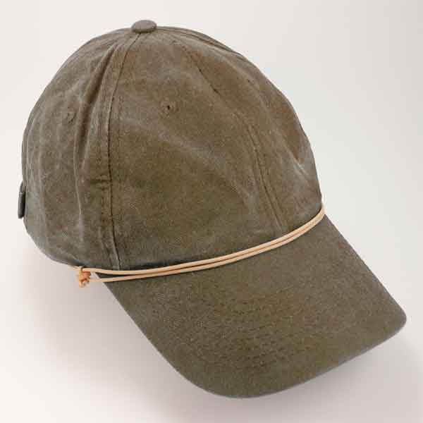 Capsurz® stows on hat brim and secures under chin