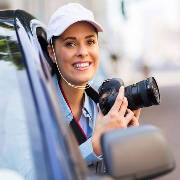 Woman taking photos from car window using Capsurz®