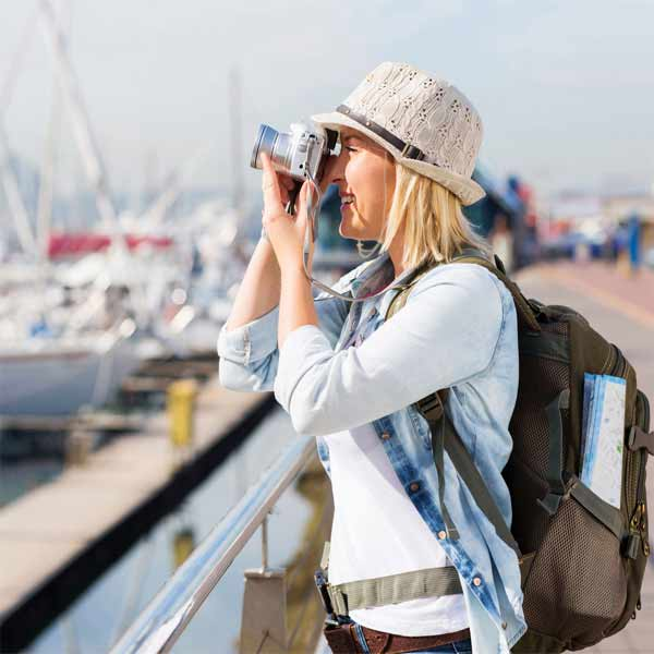 Woman backpacking with camera Capsurz under chin